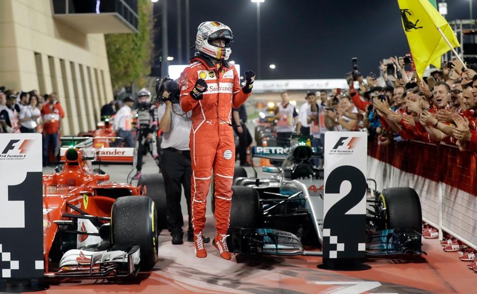 Ferrari driver Sebastian Vettel of Germany celebrates after winning the Bahrain Formula One Grand Prix, at the Formula One Bahrain International Circuit in Sakhir, Bahrain, Sunday, April 16, 2017. (AP Photo/Luca Bruno)