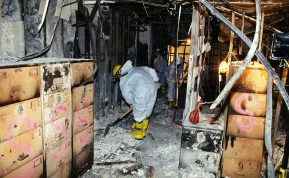 Investigators shovel ash from inside the building. In the newly released photos, the immediate devastation of the attack and the fire engulfing the building can be seen. Photo courtesy: FBI