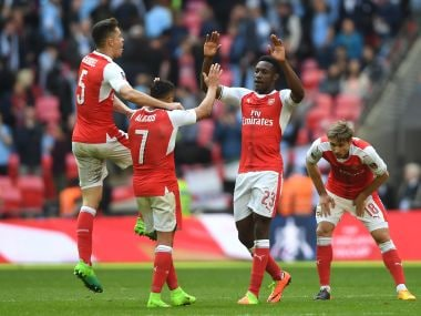 Alexis Sanchez celebrates with Arsenal teammates after their 2-1 victory. Getty