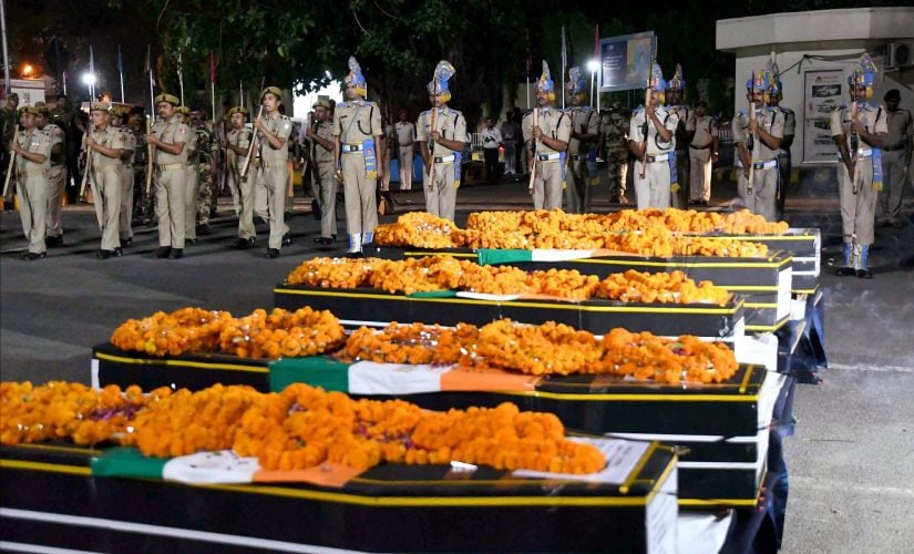 Jawans giving gun salute to martyred CRPF personnel in Patna. PTI