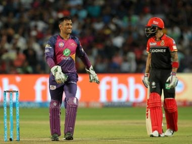 Mahendra Singh Dhoni (left) of Rising Pune Supergiant talks to Virat Kohli on Saturday. Sportzpics/IPL