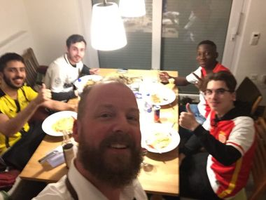 A Borussia Dortmund fan poses with AS Monaco supporters who he hosted over the night. Image courtesy: Twitter/@vespafoto