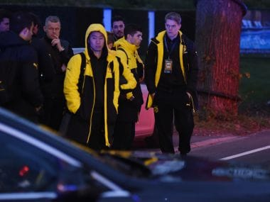 Police escort Dortmund's players after the team bus was hit with three blasts. AFP