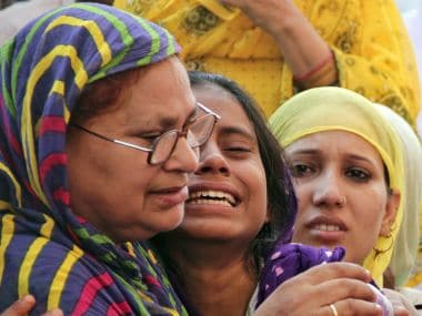 Relatives of slain Mohammad Akhlaq grieving. Reuters