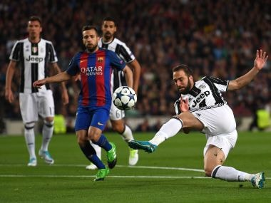 Gonzalo Higuain of Juventus volleys during the Champions League match against Barcelona. Getty