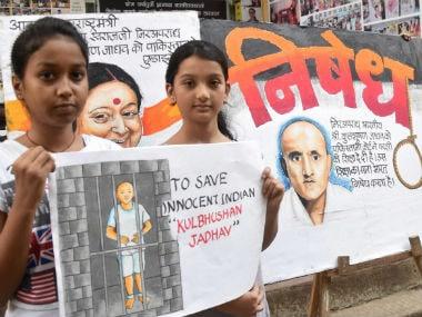 Girls in Mumbai display paintings of Kulbhushan Jadhav. PTI