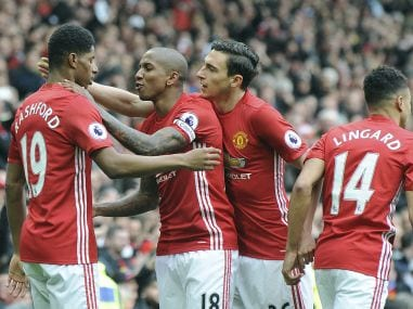 File photo of Manchester United's Marcus Rashford, left with teammates. AP