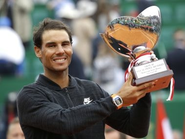 Rafael Nadal holds up his trophy after winning the Monte Carlo Masters final. AP