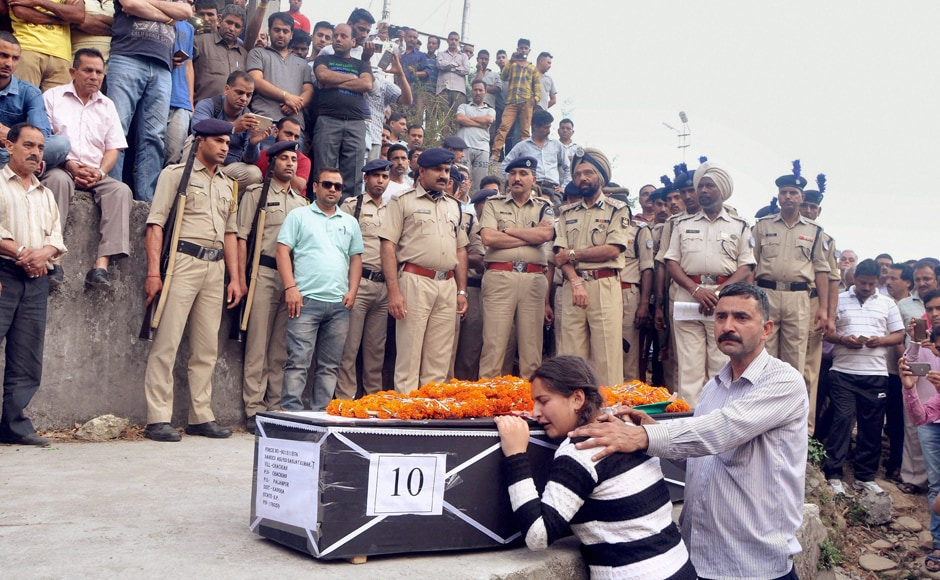 Daughter of CRPF martyr Sanjay Kumar, who was killed in the Sukma Maoist attack in Chhattisgarh, mourn the loss during his funeral at his native village Chechain Nagri near Dharamsala on Tuesday. PTI