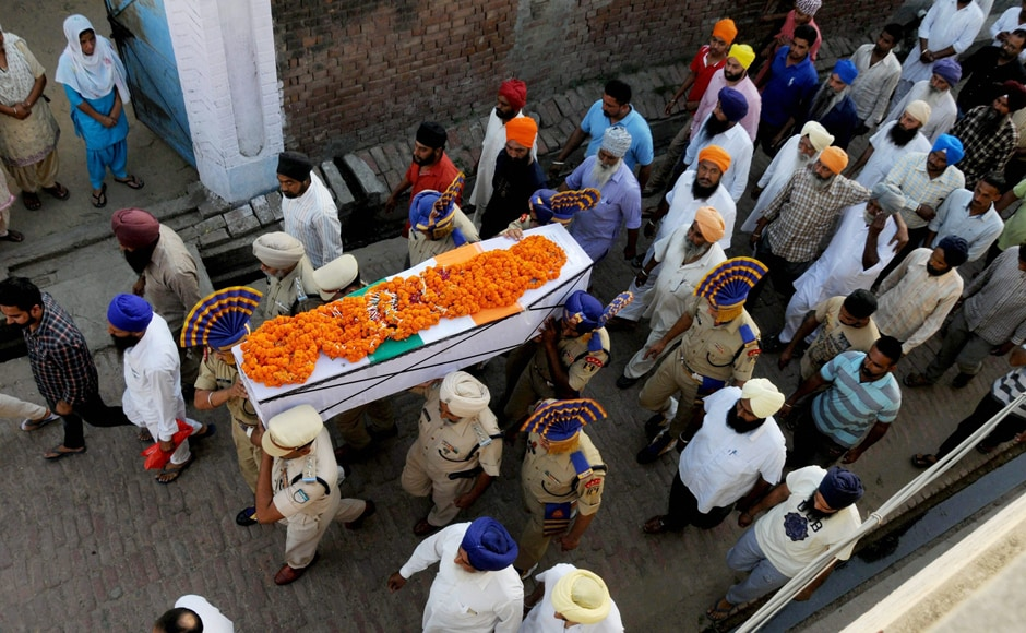CRPF martyr Inspector Raghbir Singh being carried during his funeral in village Sathiala, some 50 km from Amritsar on Tuesday. PTI