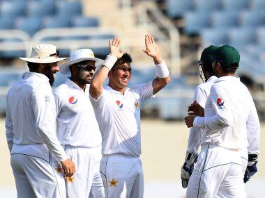 Pakistan's bowler Yasir Shah (C) celebrates with teammates after bowling out West Indies' batsman Kraigg Brathwaite. AFP