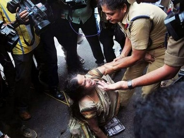 File image of police personnel attacking Jishnu Prannoy's mother. PTI