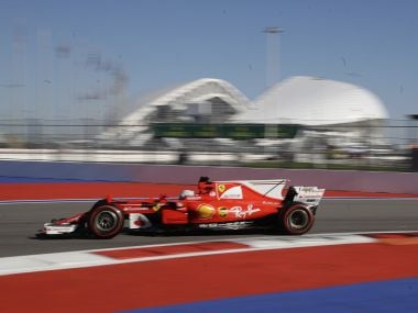 Ferrari driver Sebastian Vettel of steers his car during the second free practice session. AP