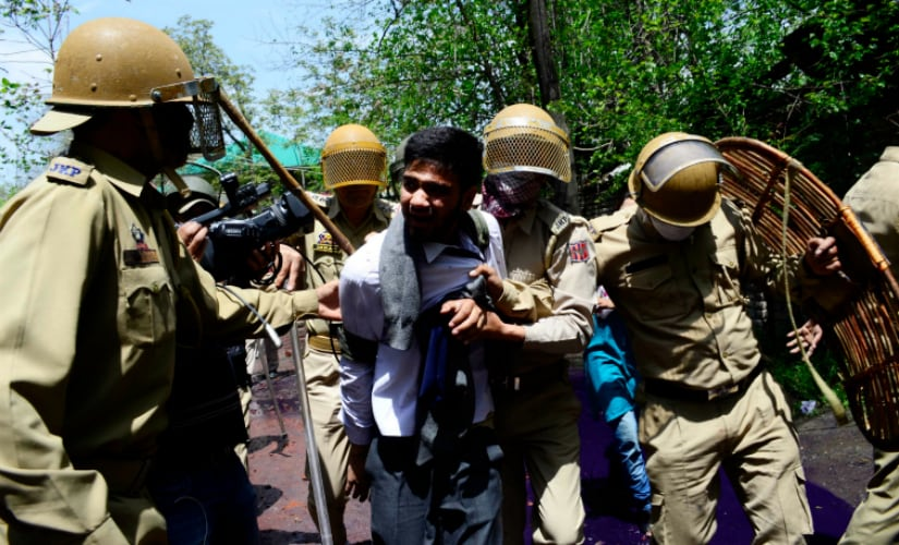 Kashmir police arresting a student of SP College in Srinagar, six students were reportedly arrested by the police on Monday. Firstpost/ Azan Shah