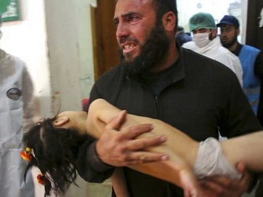 A man carrying a child following a suspected chemical attack, at a makeshift hospital in the town of Khan Sheikhoun, northern Idlib province, Syria. Syrian opposition activists said that the attack was among the worst in the country's six-year civil war. AP