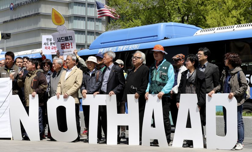 """Protesters hold letters reading """"NO THAAD"""" during a rally to oppose a plan to deploy an advanced US missile defense system called Terminal High-Altitude Area Defense, or THAAD, near US Embassy in Seoul. AP"""