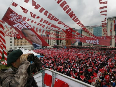 supporters of Turkey's President Recep Tayyip Erdogan, waiting for his speech, gather during a rally in his hometown city of Rize, in the Black Sea region of Turkey, Monday, April 3, 2017.
