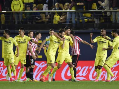 Villarreal's forward Adrian Lopez (C) celebrates a goal with teammates. AFP