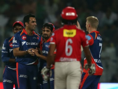 Delhi Daredevils Zaheer Khan celebrates with teammates after picking up a wicket. Sportzpics