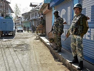CRPF personnel maintain vigil during repolls in Srinagar Lok Sabha constituency in Budgam district of Kashmir on Thursday. PTI