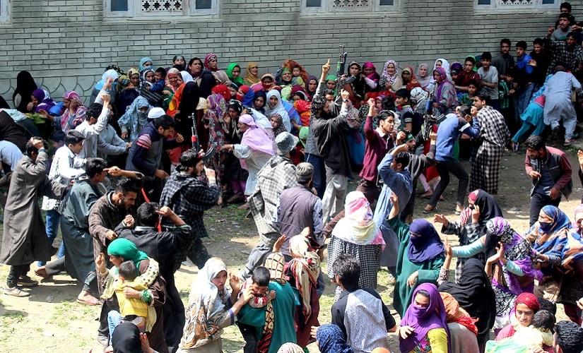 Four militants giving their slain comrade a gun salute in Kulgam. Firstpost/ Hilal Shah