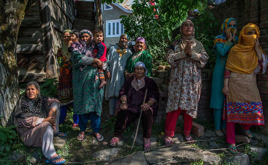 6. Last year, nearly 100 protesters were killed after militant chief Burhan Wani was killed, which went on to trigger months of anti-India protests. In this photo, Kashmiri women watch the body of rebel leader Sabzar Ahmed Bhat being displayed in Tral area, 45 Kilometers south of Srinagar. AP