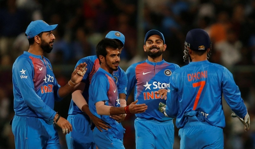 Cricket - India v England - Third T20 International - M Chinnaswamy Stadium, Bengaluru, India - 01/02/17. India's Yuzvendra Chahal (3rd L) celebrates the wicket of England's Ben Stokes. REUTERS/Danish Siddiqui
