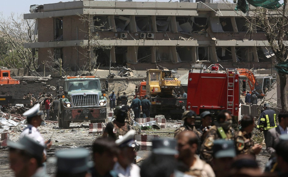 Bodies littered the scene and a towering plume of smoke rose from the area, which houses foreign embassies. Security forces are seen in front of the German Embassy after the suicide car bombing in Kabul. AP