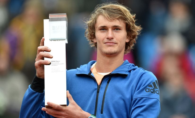 Alexander Zverev holds the winner trophy after defeating Guido Pella in the final match  at the BMW Open in Munich. AFP