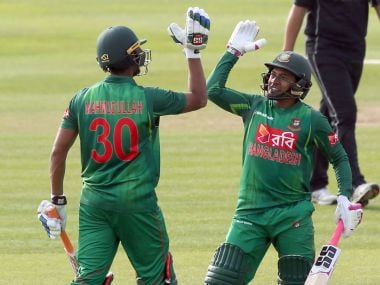 Bangladesh's Mahmudullah (L) celebrates after hitting the winning runs to beat New Zealand in the Tri-Series final One-Day International between Bangladesh and New Zealand at Clontarf cricket ground in Dublin on May 24, 2017. / AFP PHOTO / Paul FAITH