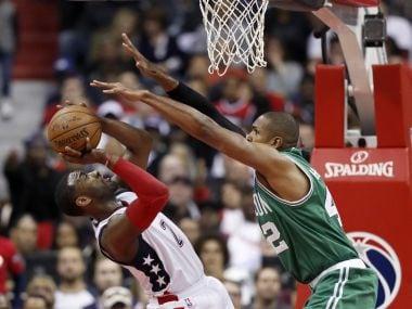 Washington Wizards guard John Wall (2) against Boston Celtics center Al Horford (42). AP