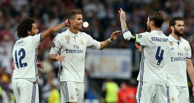 Real Madrid's Cristiano Ronaldo and Sergio Ramos celebrate their win over Atletico. Reuters