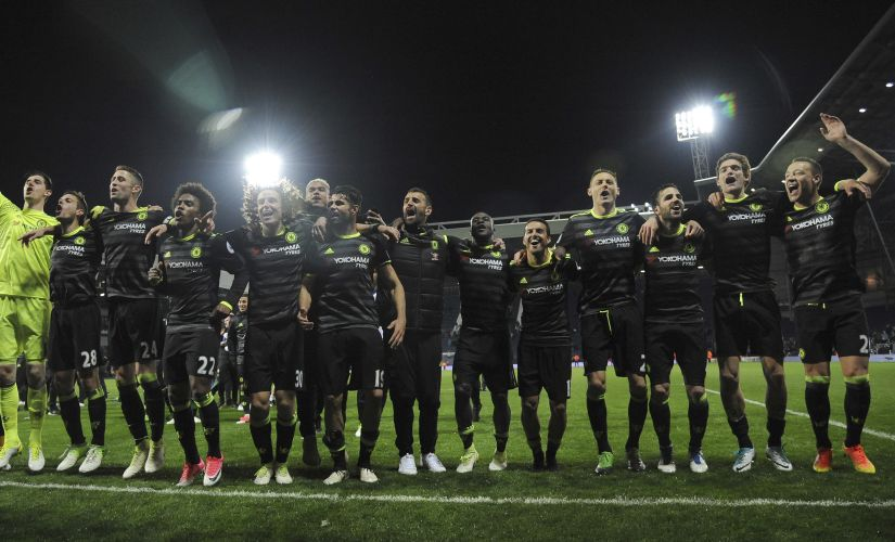 Chelsea's players celebrate after wrapping up the English Premier League title. AP