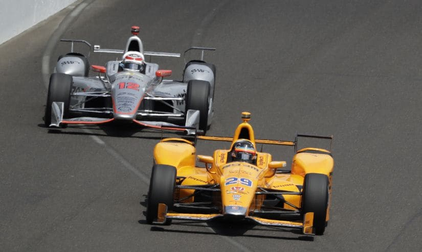 Fernando Alonso leads Will Power into the first turn in the opening laps of the Indianapolis 500. AP