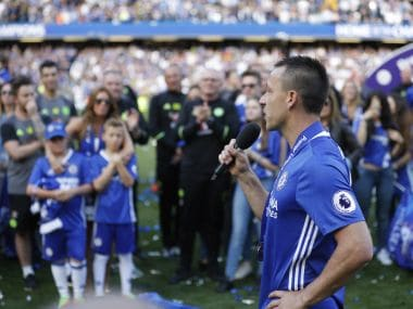 Chelsea captain John Terry addresses the crowd after they won the league, following the English Premier League soccer match between Chelsea and Sunderland at Stamford Bridge stadium in London, Sunday, May 21, 2017. (AP Photo/Frank Augstein)