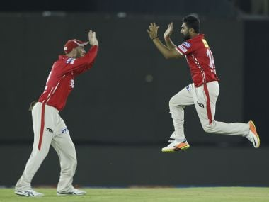 Rahul Tewatia of Kings XI Punjab celebrates the wicket of Kolkata Knight Riders' Robin Uthappa. SPortzpics