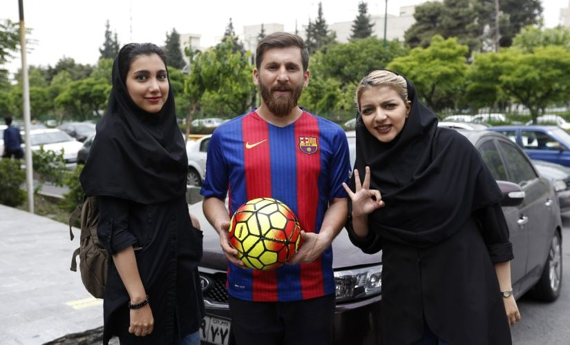 Lionel Messi's lookalike Reza Parastesh poses with fans in Iran. AFP