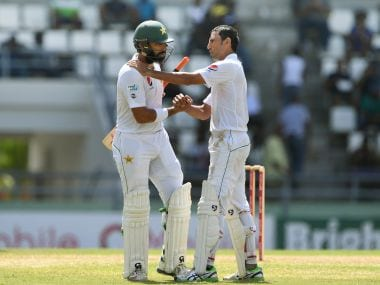 Pakistan captain Misbah-ul-Haq (left) is greeted by teammate  Younis Khan on Saturday. AFP