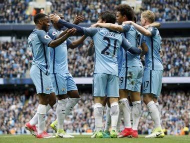 Manchester City's David Silva, center, celebrates scoring against Leicester. AP