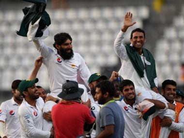 Misbah-ul-Haq (L) and Younis Khan (R) are carried by teammates as they celebrate after winning the final Test match. AFP
