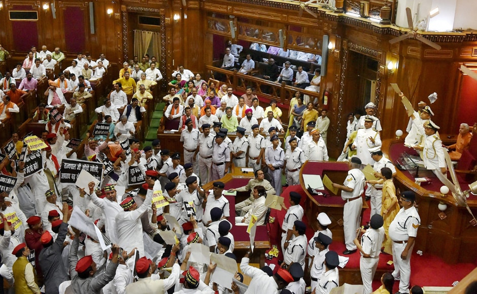 MLAs from both the parties raised slogans and whistled during Governor Ram Naik's speech, even throwing paper balls at the Governor. Marshall's had to use paper files to shield the Governor as he was making his speech. <em>PTI</em>