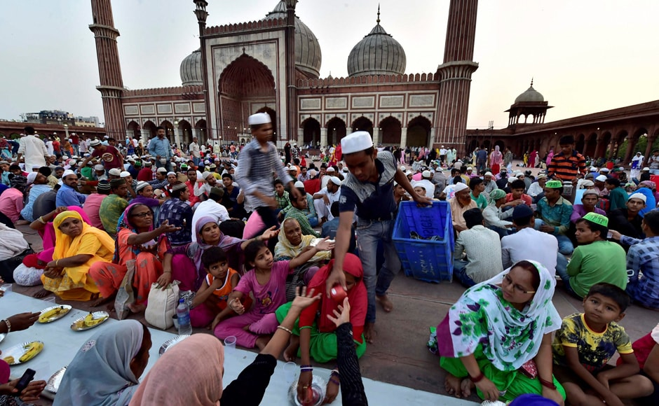 Muslims who are fasting get up early to eat a pre-dawn meal called suhoor and then break their fast with a meal referred to as iftar. In the picture, Muslims have gathered at Jama Masjid in Delhi to break their fast. PTI