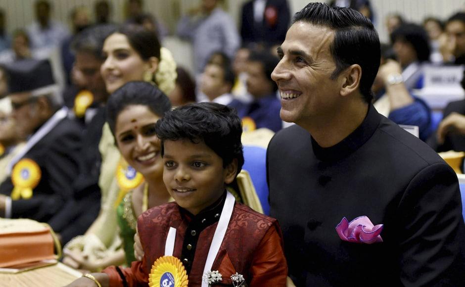 Best Actress Award winner Surabhi CM, child actor Adish Praveen and Akshay Kumar. PTI