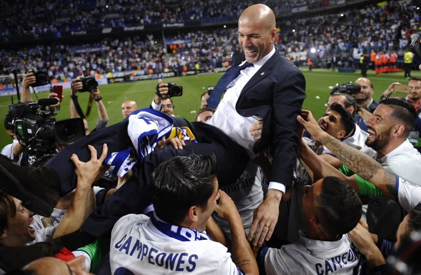 Real Madrid's head coach Zinedine Zidane is thrown into the air by his players after winning La Liga title win. AP