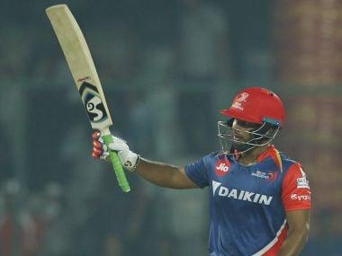 Rishabh Pant of Delhi Daredevils raises his bat after crossing 50 runs against Gujarat Lions. Sportzpics