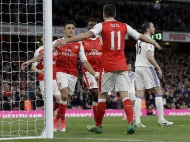 Arsenal's Alexis Sanchez, left, celebrates scoring his side's first goal with Mesut Ozil. AP
