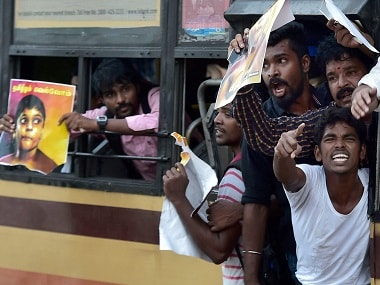 Police detain pro-Tamil activists at Chennai's Marina beach. PTI