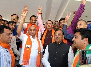 File image of Gujarat chief minister Vijay Rupani with party members. PTI