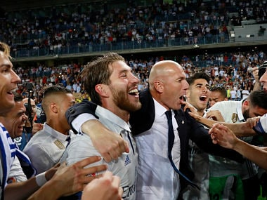 Zinedine Zidane, with his players after Real Madrid won the La Liga title. Getty Images