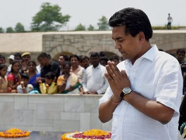 Sacked Delhi water minister Kapil Mishra pays tribute at Mahatma Gandhi's memorial before addressing the media at Rajghat in New Delhi on Sunday. PTI